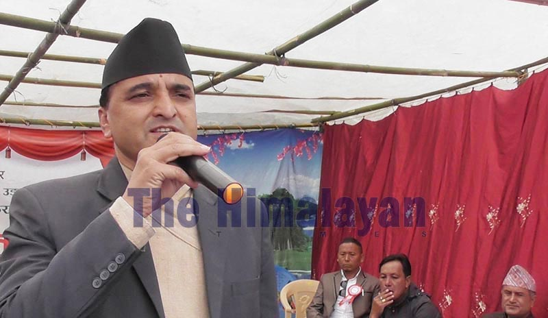 Minister of Tourism and Civil Aviation Yogesh Bhattarai speaking at a programme organised in Aathrai Rural Municipality, Tehrathum, on Thursday, October 24, 2019. Photo: THT