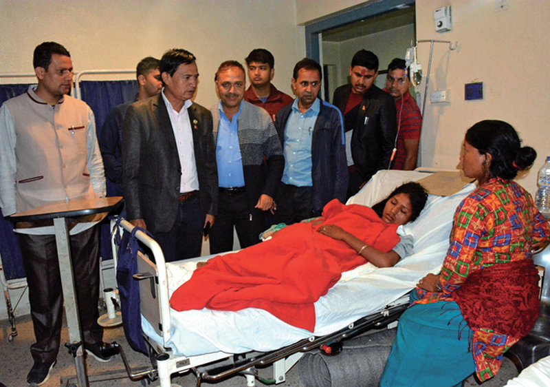 Former law minister Sher Bahadur Tamang (second from left) visiting Shir Memorial Hospital to inqire about the injured in Banepa, on Saturday. Photo: RSS