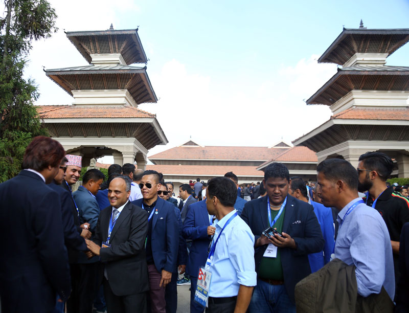 Candidate Kumar Pant shakes hand with voters during the election of Non-Resident Nepali Association, on Thursday. Photo: RSS