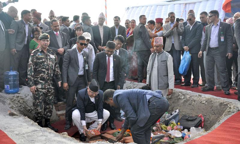 FILE - PM Oli laying foundation stone for Nagdhunga-Sisnekhola Tunnel Road amid a programme held at Totepakha of Chandragiri Municipality-1 on October 21, 2019. Photo: RSS