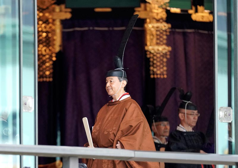 Japanese Emperor Naruhito leaves the ceremony hall after proclaiming his enthronement at the Imperial Palace in Tokyo, Japan, 22 October 2019. Photo: Kimimasa Mayama/Pool via Reuters