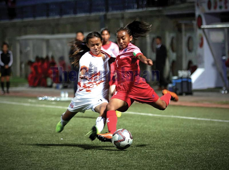 Nepalu2019s Preeti Rai vies for the ball with Bhutanu2019s Tsering Choden during their SAFF U-15 Womenu2019s Championship match at the Changlimithang Stadium in Thimpu on Sunday, October 13, 2019. Photo Courtesy: NSJF