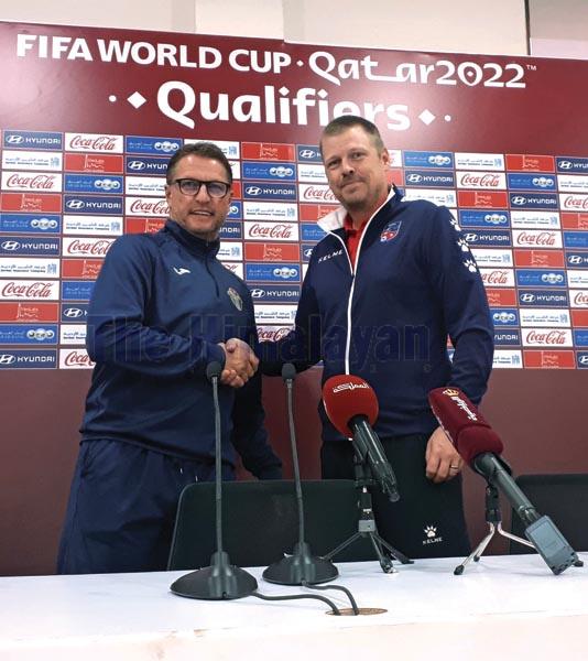 `Nepal national football team head coach Johan Kalin (right) shakes hands with his Jordan counterpart Vital Borkelmans at a pre-match press meet in Amman on Monday. Photo: THT