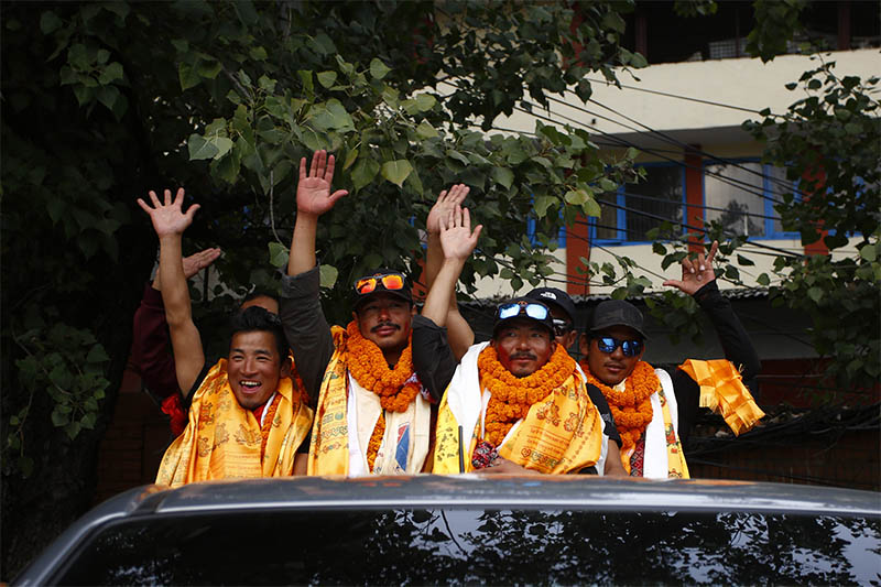 Nirmal 'Nims' Purja (36) (S-L) along with his team of Project Possible wakes hands upon their arrival after successfully scaling all 14 mountains above 8,000 m in just over six months setting the world record in Kathmandu, on Wednesday, October 30, 2019. Photo: Skanda Gautam/ THT