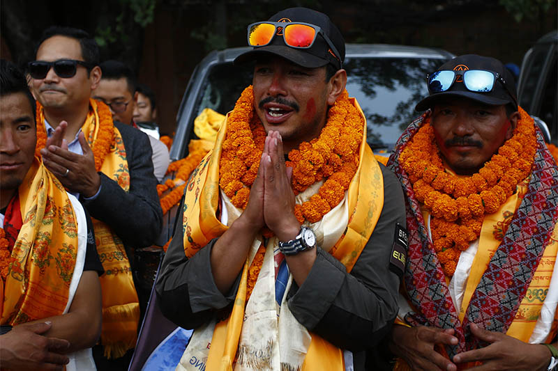 Nirmal 'Nims' Purja (36) along with his team of Project Possible gesture upon their arrival, after successfully scaling all 14 mountains above 8,000 m in just over six months setting the world record, in Kathmandu, on Wednesday, October 30, 2019. Photo: Skanda Gautam/THT