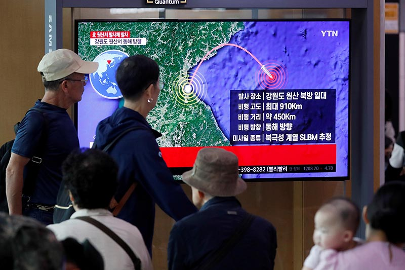 File - People watch a TV broadcasting a news report on North Korea firing a missile that is believed to be launched from a submarine, in Seoul, South Korea, on Wednesday, October 2, 2019. Photo: Reuters