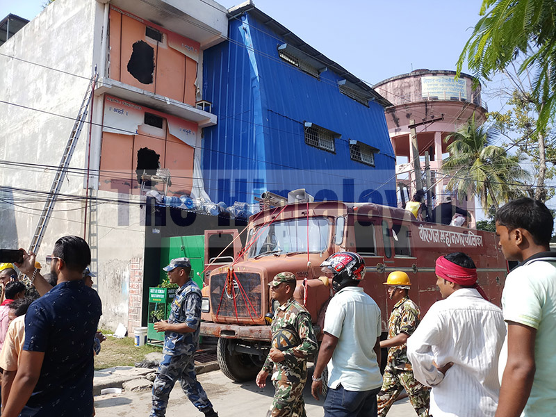Security personnel and locals along with a fire engine from Birgunj Metropolitan City at Om Sai Drinking Water Industry, Birgunj, where a fire damaged property worth millions, on Saturday, October 12, 2019. Photo: Ram Sarraf/THT