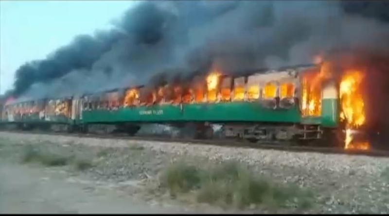 A fire burns a train carriage after a gas canister passengers were using to cook breakfast exploded, near the town of Rahim Yar Khan in the south of Punjab province, Pakistan October 31, 2019, in this still image take from video. Photo: REUTERS TV via Reuters