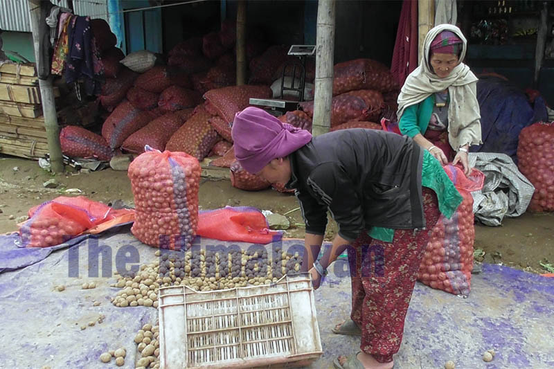 Farmers bringing locally produced potato at the vegetable collection centre in Rake bazaar of Panchthar district, on Wednesday, October 02, 2019. Photo: Laxmi Gautam/THT