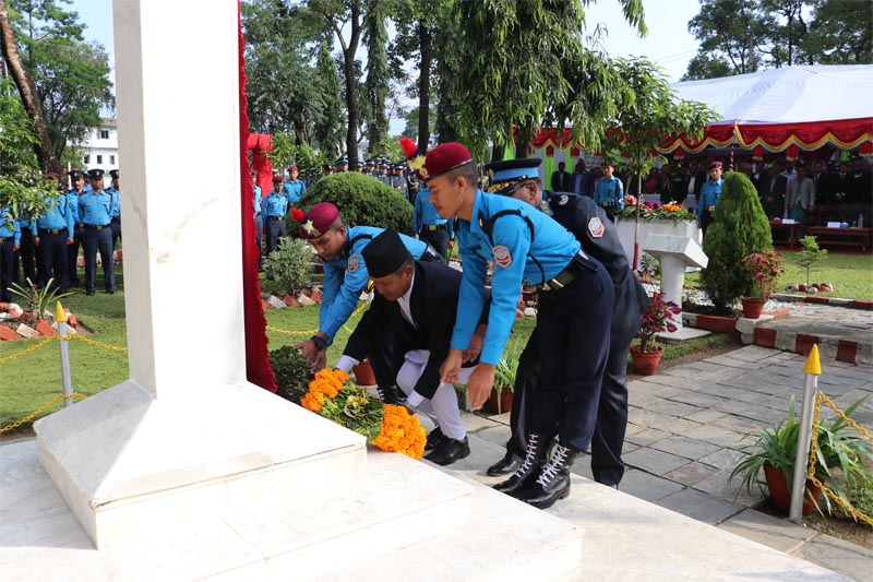 Chief Minister of Gandaki Province, Prithvi Subba Gurung, offering a flower wreath at a monument during the programme organised on the occasion of 64th Nepal Police Day, in Pokhara. Photo: Rishi Ram Baral/THT