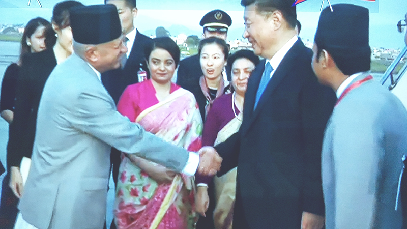 Minister for Foreign Affairs Pradeep Kumar Gyawali shakes hands with President of the People's Republic of China, Xi Jinping (right), upon  has arrival in Tribhuvan International Airport, Kathmandu, on Saturday, October 12, 2019. The Chinese president is on two-day state visit to Nepal at the invitation of his Nepali counterpart Bidya Devi Bhandari. Photo: Ram Sarraf/screenshots of NTV live broadcast
