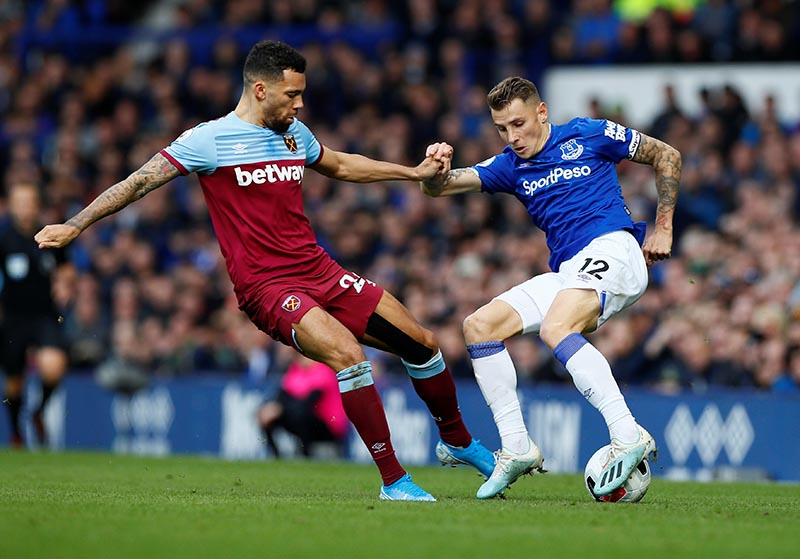 Everton's Lucas Digne in action with West Ham United's Ryan Fredericks during the Premier League match between Everton and West Ham United, at Goodison Park, in Liverpool, Britain, on October 19, 2019. Photo: Action Images via Reuters