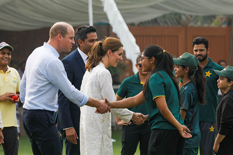 Britain's Prince William and Catherine, Duchess of Cambridge, shake hands with children participants of the British Council's DOSTI (friendship) program at the National Cricket Academy in Lahore, Pakistan October 17, 2019. Photo: Reuters