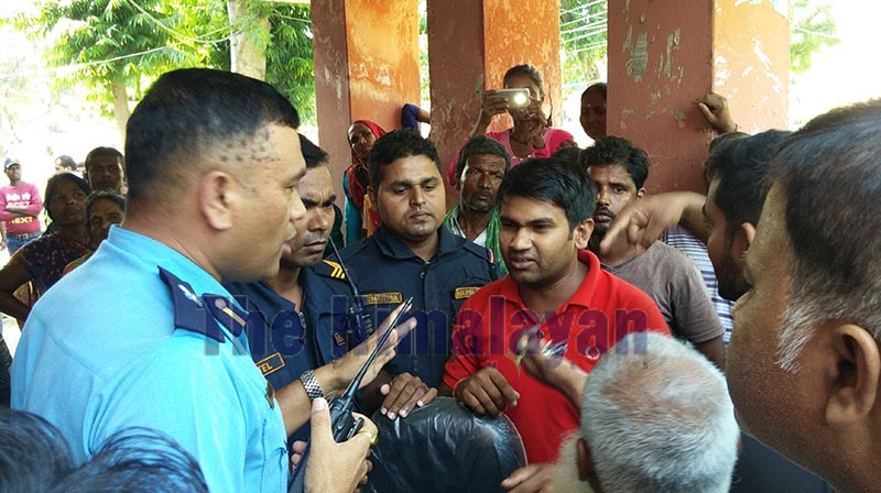 Police convincing irate locals after Gajendranarayan Singh Hospital was vandalised in Rajbiraj, Saptari, on Monday. Photo: THT