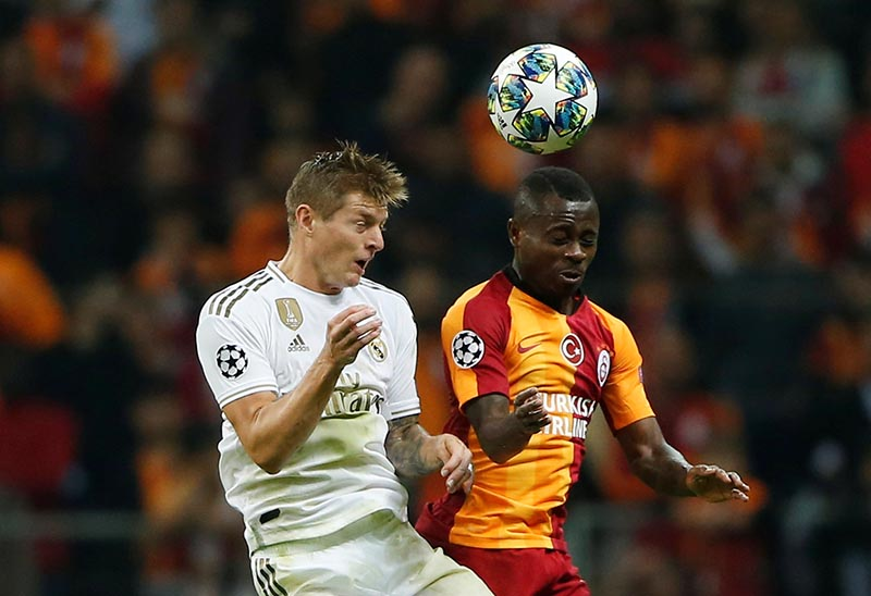 Real Madrid's Toni Kroos in action with Galatasaray's Jean Michael Seri during the Champions League Group A match between Galatasaray and Real Madrid, at Turk Telekom Stadium, in Istanbul, Turkey, on October 22, 2019. Photo: Reuters