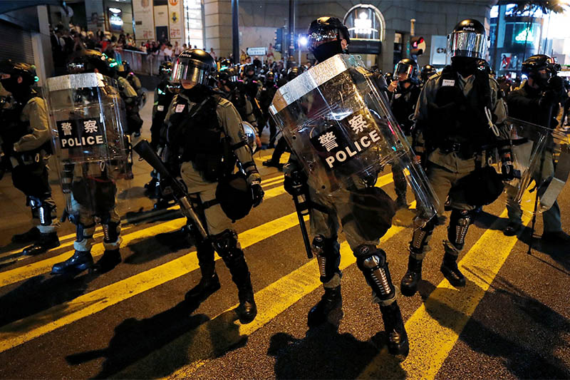 Riot police officers stand guard during an anti-government protest during Halloween in central area of Hong Kong, China October 31, 2019. Photo: Reuters