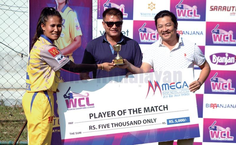Kat Queens Kathmandu skipper Rubina Chhetri Belbashi receiving the player-of-the-match trophy after her teamu2019s victory over Biratnagar Titans in the eliminator match of the WCL at the TU Stadium on Tuesday, October 22, 2019. Photo: THT