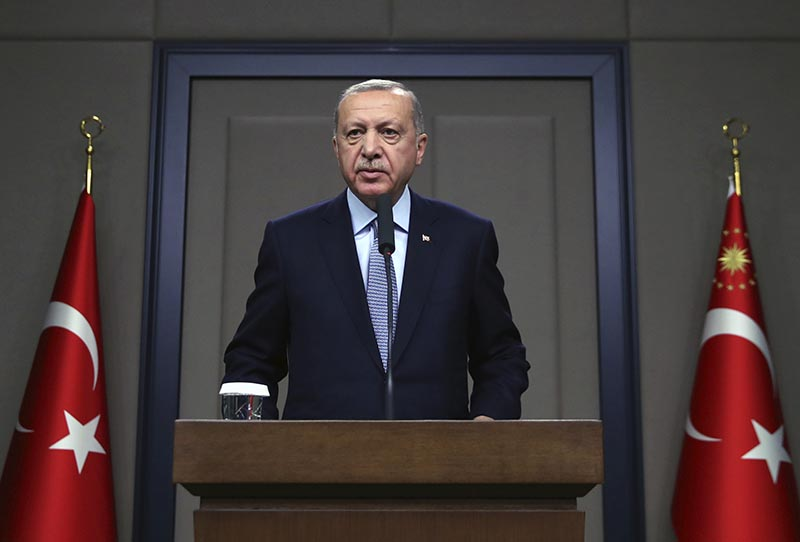 Turkish President Recep Tayyip Erdogan talks to reporters before traveling to Russia to meet with Russian President Vladimir Putin, in Ankara, Tuesday, Oct. 22, 2019. Photo: AP