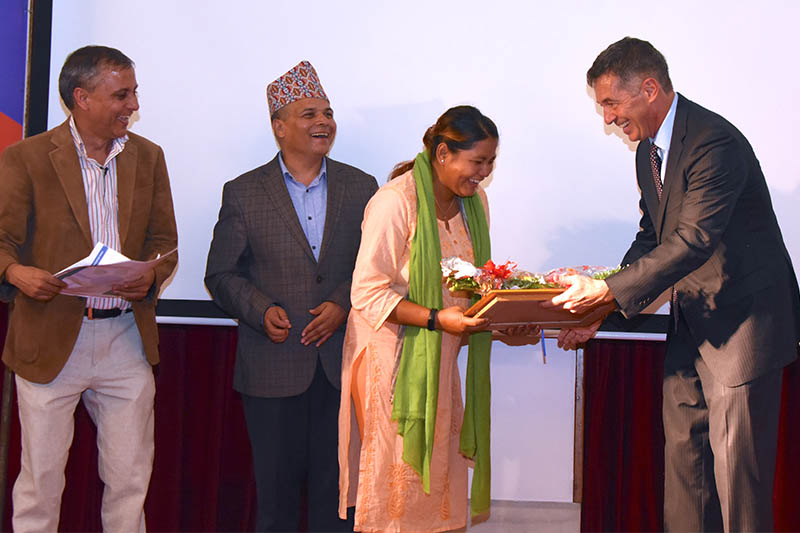 Nagariknews reporter Sabita Shrestha receives National Investigative Journalism Fellowship award from the US Ambassor to Nepal Randy Berry in Kathmandu, on Tuesday, October 01, 2019. Courtesy: Sudhir Mahat