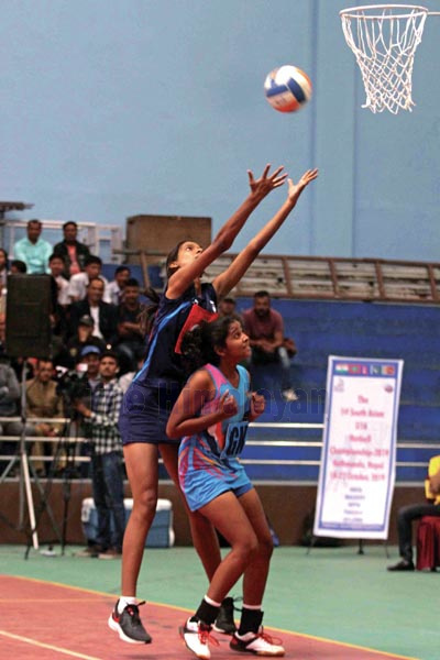 Players from India and Sri Lanka (right) vie for the ball during the final match of the first South Asian Netball Championship at the Nepali Army Sports Complex in Lalitpur on Tuesday. Photo: THT