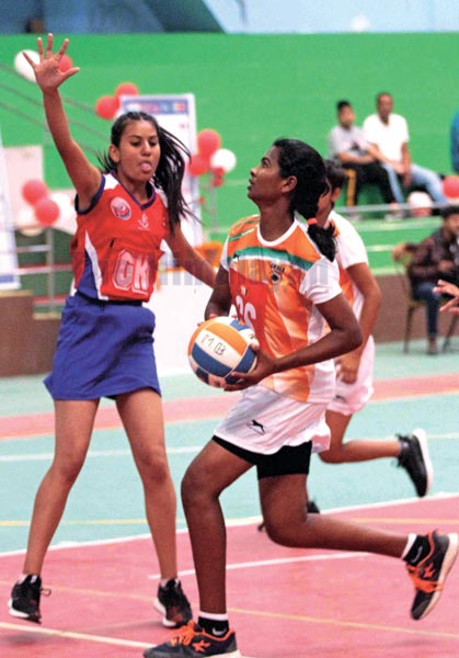 Players of Nepal (left) and India vie for the ball during their South Asian U-16 Netball Championship match on Saturday, October 19, 2019. Photo: THT