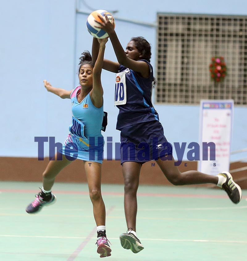 Players of India and Sri Lanka (left) vie for the ball during their South Asian U-16 Netball Championship match in Lalitpur on Friday, October 18, 2019. Photo: THT