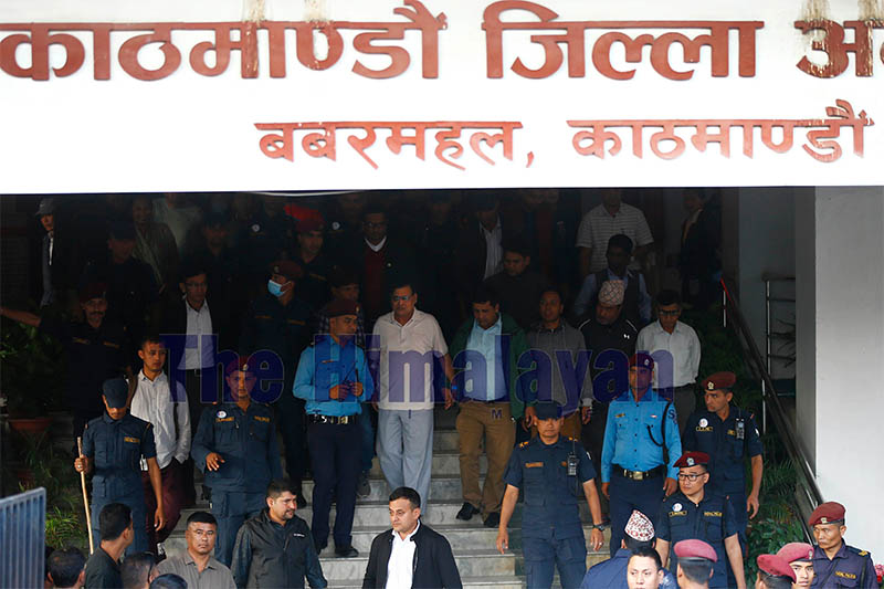 Former speaker of the House of Representatives, Krishna Bahadur Mahara, (C) leaves the Kathmandu District Court after giving his statement following accusation by a female government employee who accused him of rape in Kathmandu, Nepal on Tuesday, October 15, 2019. Photo: Skanda Gautam/THT