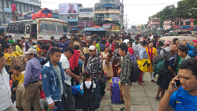 Travellers who have been stranded in lack of sufficient vehicles during Dashain festival, in Bhanuchok, Dharan, on Friday, October 4, 2019. Photo: Santosh Kafle/THT