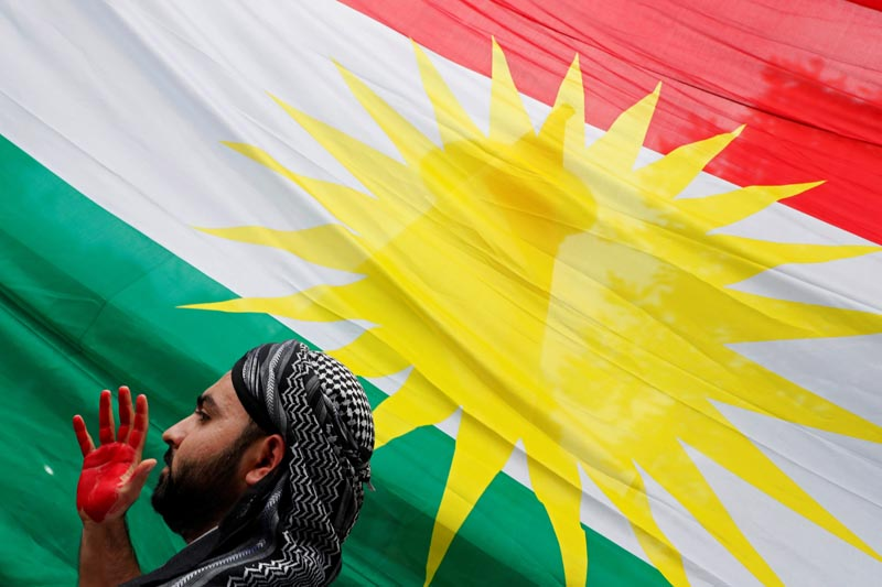 A man is seen next to Kurdistan's flag as members of The American Rojava Center for Democracy, an organization that advocates for freedom, democracy, and peace in Syria, take part with other activists in a rally to protest Turkey's incursion into Kurdish-controlled northeast Syria and urge US action against Turkey, outside the White House in Washington, US, October 12, 2019. Photo: Reuters