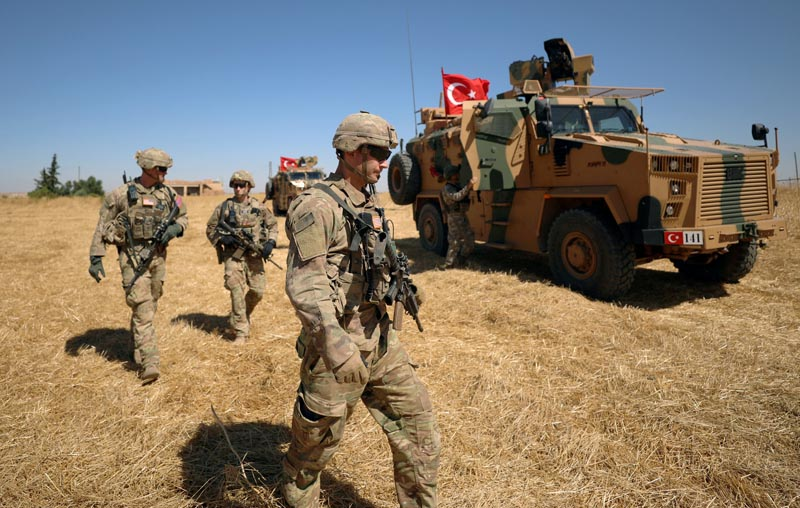 American soldiers walk together during a joint US-Turkey patrol, near Tel Abyad, Syria September 8, 2019. Photo: Reuters/File