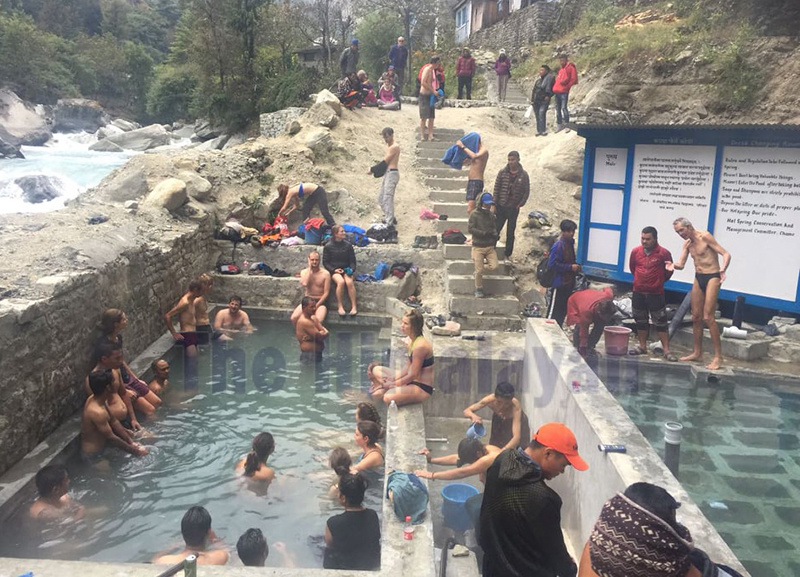 Tourist taking hot spring bah in Tatopani Kunda  in Chame Rural Muniocipality of Manang district, on Saturday. Photo: THT