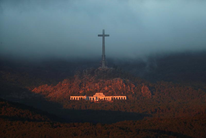 The Valle de los Caidos (The Valley of the Fallen), the state mausoleum where late Spanish dictator Francisco Franco is buried, is seen at dusk in San Lorenzo de El Escorial in this picture taken from Guadarrama, near Madrid, Spain, October 24, 2019. Photo: Reuters