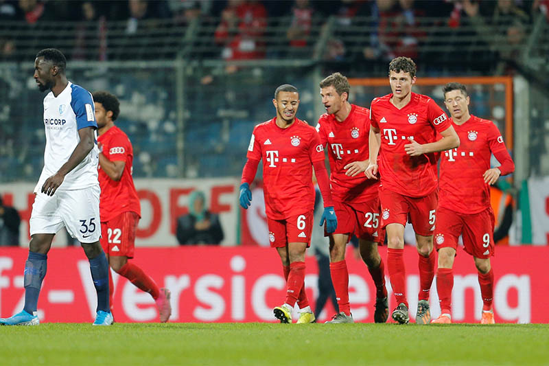 Bayern Munich's Thomas Muller celebrates scoring their second goal with Thiago and teammates. Photo: Reuters
