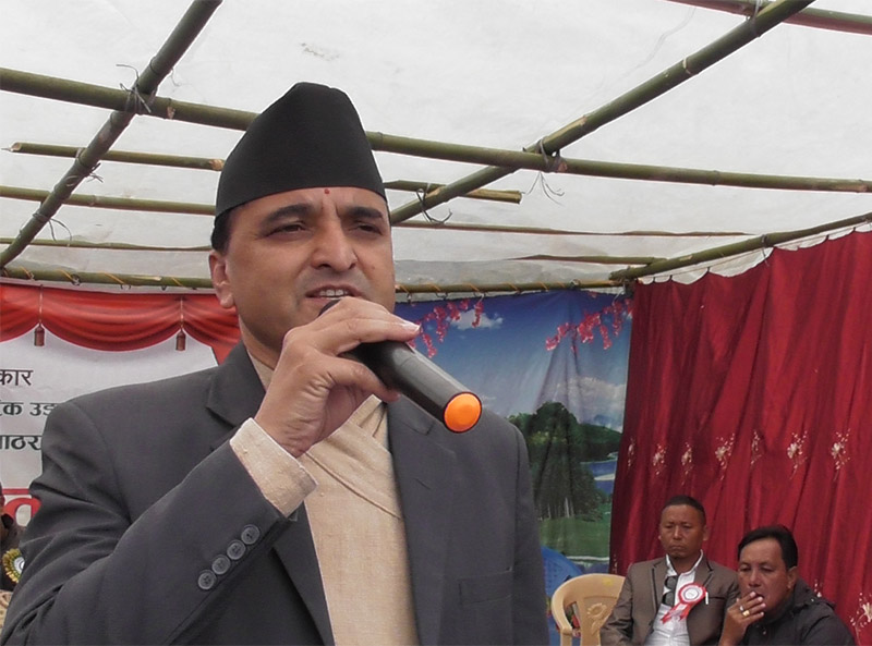 Minister for Culture, Tourism and Civil Aviation Yogesh Bhattarai speaking at a programme, at the construction site of Aathrai airport, in Tehrathum district, on Thursday, October 24, 2019. Photo: Laxmi Gautam/THT