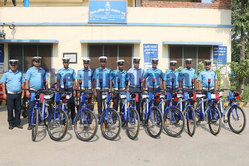 Traffic police personnel pose for a portrait along with bicycles at the District Traffic Police Office, Parsa, in Birgunj, on Thursday, October 24, 2019. Photo: Ram Sarraf/THT