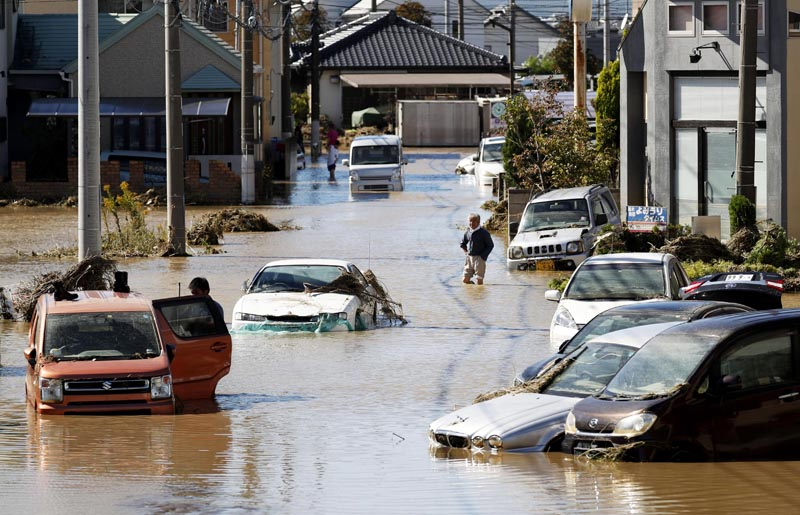 Vehicles are seen in mud water as Typhoon Hagibis hit the city in Sano, Tochigi prefecture, Sunday, October 13, 2019. Photo: Kyodo News via AP