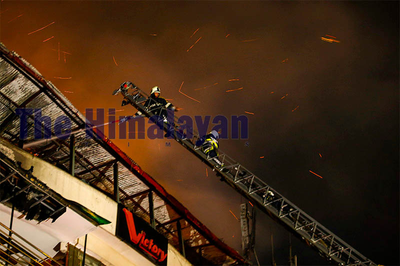 Firefighters douse a massive fire at Victory Lounge in Kathmandu, on Sunday, October 13, 2019. An electric short circuit sparked fire and no human casualties were reported in the incident. Photo: Skanda Gautam/THT