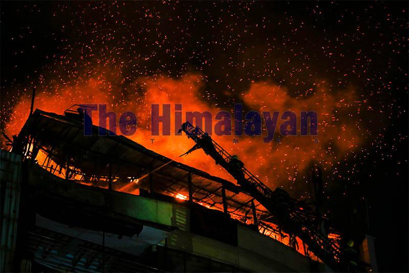 Firefighters douse a massive fire at Victory Lounge in Kathmandu. Photo: Skanda Gautam/THT