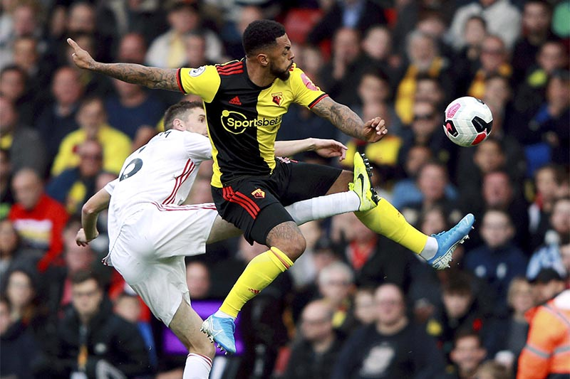 Sheffield United's Chris Basham, left, and Watford's Andre Gray battle for the ball during the English Premier League soccer match at Vicarage Road, Watford, England, Saturday, October 5, 2019. Photo: Ian Walton/PA via AP)