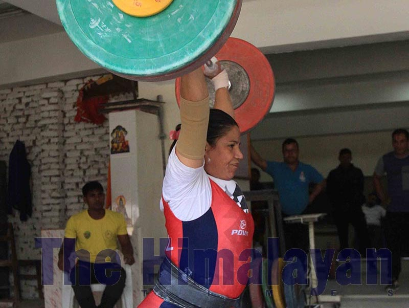 Nepal Police Club lifter Raj Laxmi Thapa lifts weight during the 71kg section of the final selection for the 13th South Asian Games at the Dasharath Stadium hall in Kathmandu on Friday, October 4, 2019. Photo: Udipt Singh Chhetry/THT
