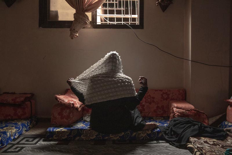 In this July 20, 2019 photo, 20-year-old Ethiopian migrant Zahra, a rape victim, adjusts her veil for a photograph, in Basateen, a district of Aden, Yemen. She was imprisoned for a month in a tin-roofed hut, broiling and hungry, ordered to call home each day to beseech her family to wire $2,000. Photo: AP