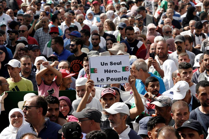 Demonstrators march during a protest opposing the election that Algeria's veteran ruling cadre has set for December, in Algiers, Algeria October 1, 2019. Photo: Reuters