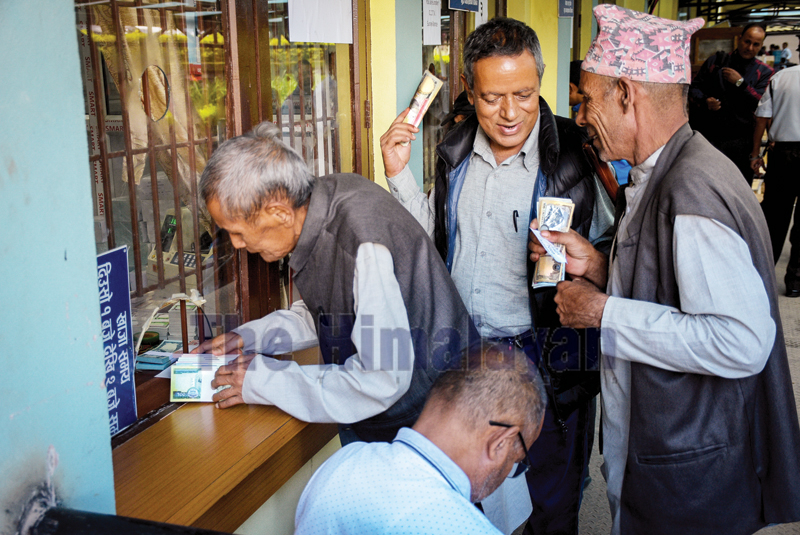 People queuing to exchange old banknotes with the fresh banknotes for the Dashain festival at the Nepal Rastra Bank, in Baluwatar, on Tuesday. Photo: Naresh Krishna Shrestha/THT