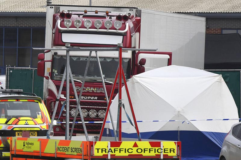 View of a truck, seen in rear, that was found to contain a large number of dead bodies, in Thurrock, South England, early Wednesday on October 23, 2019. Photo: AP