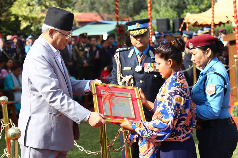 Home Minister Ram Bahadur Thapa handing over a certificate of appreciation to the families of martyred police personnel at the programme organised to mark the 64th Nepal Police Day, in Kathmandu, on Friday, October 11, 2019. Photo: RSS