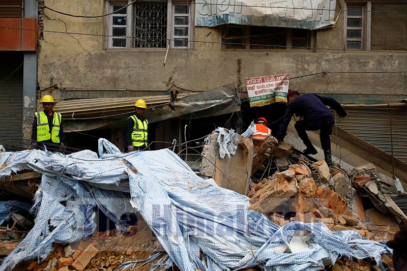 Police personnel work at the site where an old building that was being demolished collapsed, critically injuring a labourer working at the site and a pedestrian, at Chabahil, in Kathmandu, on Wednesday, October 23, 2019. Photo: Skanda Gautam/ THT