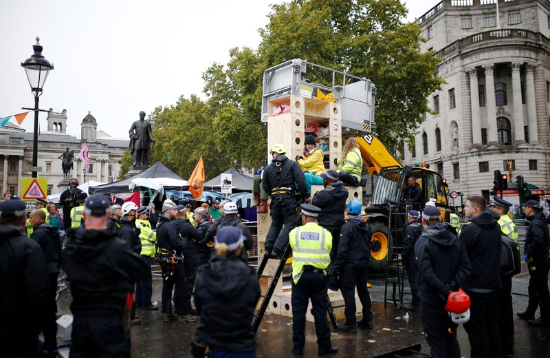 Police remove protesters at the Trafalgar Square during an Extinction Rebellion demonstration in London, Britain, October 12, 2019. Photo: Reuters