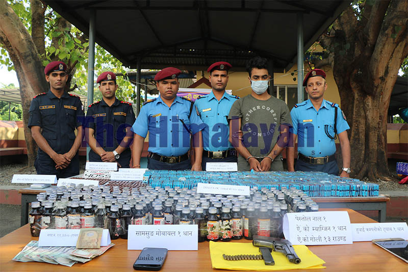 Police making public alleged drug peddler along with the seized items -- illegal drugs, arms and ammunition at District Police Office, in Dharan, on Monday, October 14, 2019. Photo: Santosh Kafle/THT