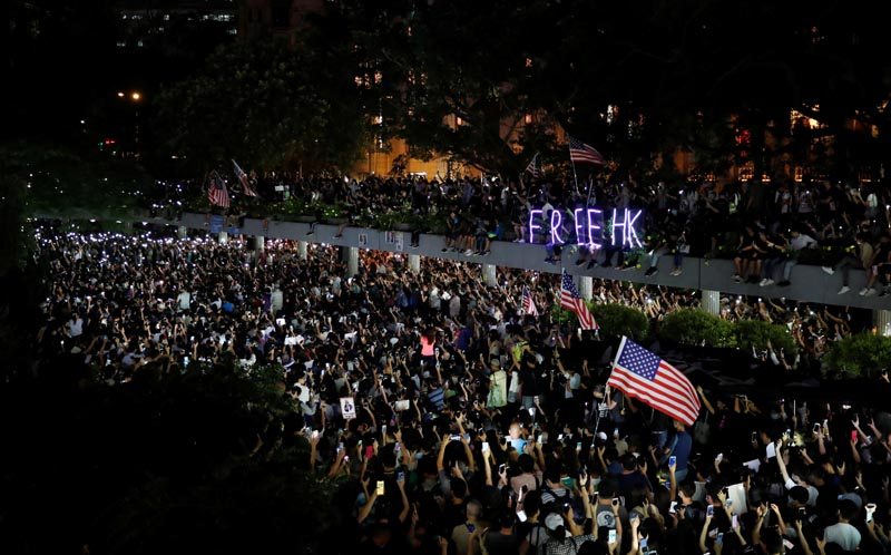 Anti-government demonstrators march in protest against the invocation of the emergency laws in Hong Kong, China, October 14, 2019. Photo: Reuters