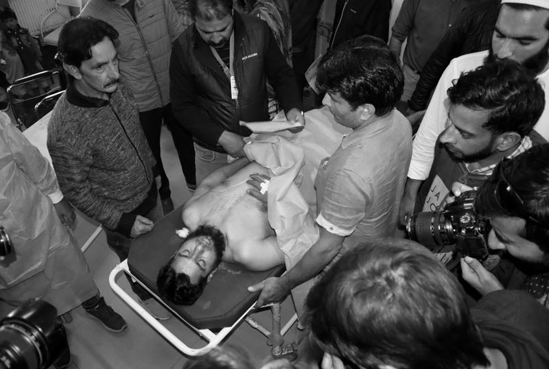 An injured man is rushed to a hospital for treatment after a grenade attack in Srinagar October 12, 2019. Photo: Reuters